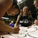 Colorado freshman forward Zoe Beard-Fails (31) signs autographs for Mariana Vadas-Arendt, 10 years old, left, and Megan Zingerman, 10. (Kai Casey/CU Independent)