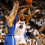 Colorado forward Josh Scott (40) is fouled by a UCLA defender while going up for the basket. (Nigel Amstock/CU Independent)