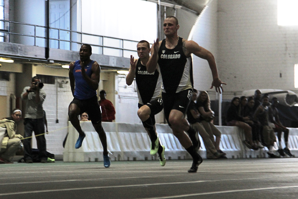 Senior Shaw Gifford, and freshman Austin Mitsch race in the 60 meter dash final, Saturday at the Potts Indoor Invitational in Balch Fieldhouse. Gifford placed first with a time of 6.76 and Mitsch placed third at 7.06. (Matt Sisneros/CU Independent)