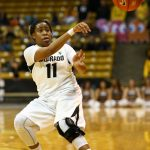 Senior guard Brittany Wilson passes the ball at the Coors Event Center. (Nigel Amstock/CU Independent)