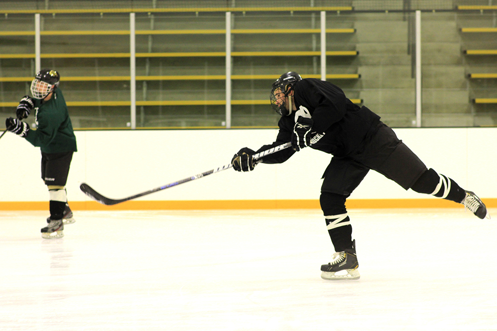 Junior defenseman, Luc Neitenbach, takes a shot on goal during practice on Tuesday, Jan 21, 2014. (Matt Sisneros/CU Independent)