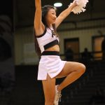 A Colorado cheer squad member pumps up the crowd in the first half. (Maddie Shumway/CU Independent)