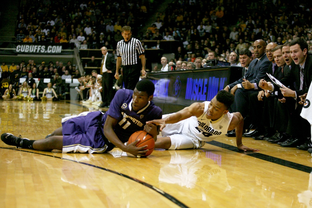 Colorado's George King and Washington's Mike Anderson fight for a ball during the first half of a game in Feb. 2014. (James Bradbury/CU Independent File)