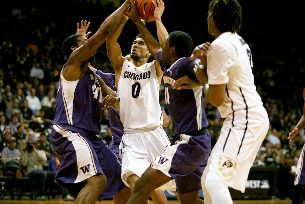 Junior guard Askia Booker (0) makes his way toward the basket during Colorado's 91-65 win over Washington Feb. 9, 2014 in Boulder, Colo. Booker finished the game with 20 points. (James Bradbury/CU Independent)