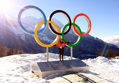 Julia Marino poses for a photo in front of the Olympic rings in Sochi. (Photo Courtesy of Julia Marino)