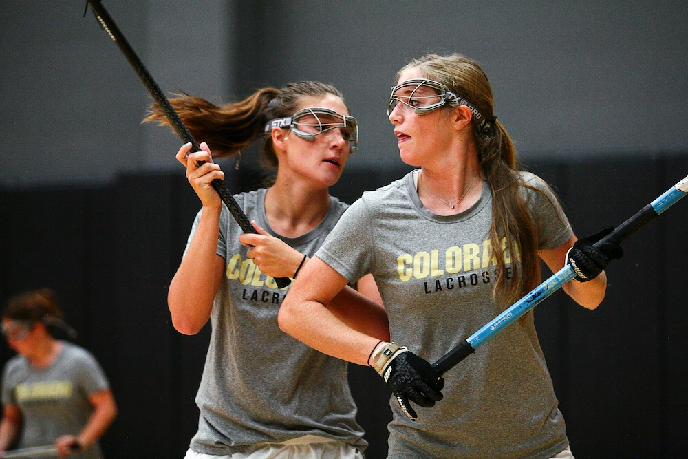 Marie Moore, right, and Annie Morsches run through a ball possession drill during an individuals practice in the Coors Events Center in Boulder, Wednesday, Sept. 11, 2013. (Kai Casey/CU Independent)