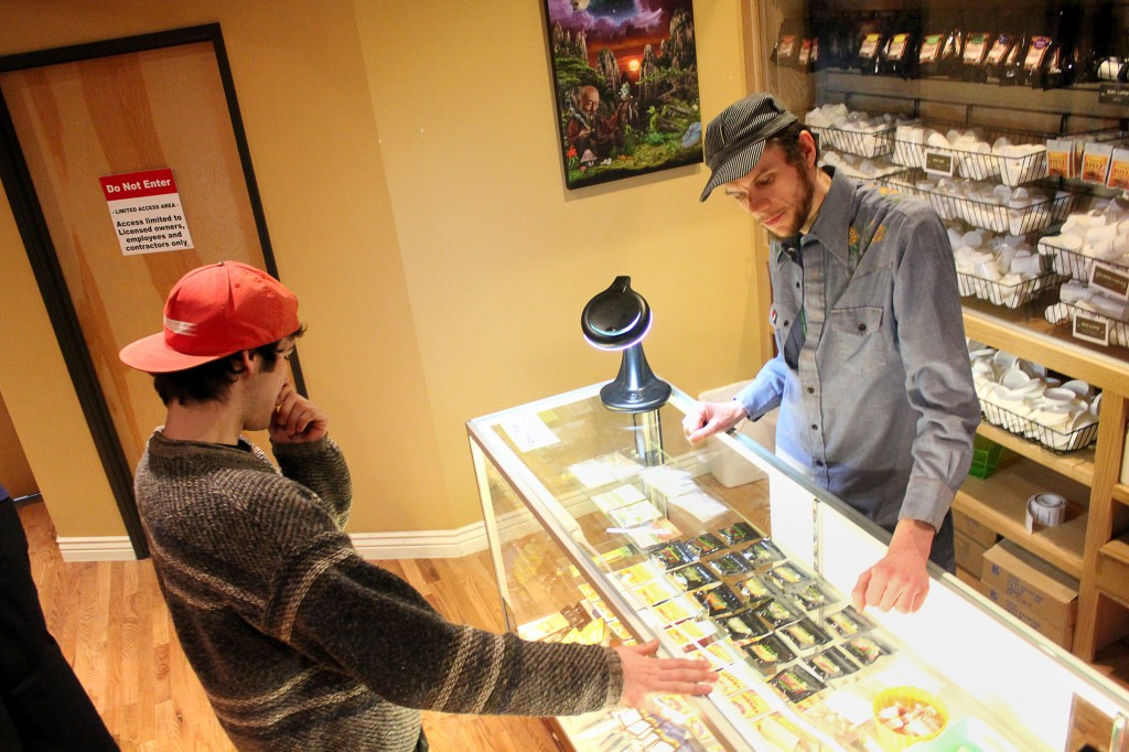 Jacob, last name not given, right, helps Matt, last name not given, decide on a strain of weed at the Terrapin Care Station, Tuesday, Feb. 18, 2014, in Boulder, Colo. The Terrapin Care Station, located at the corner of Folsom Street and Canyon Boulevard, was the first recreational pot shop to open in the city of Boulder. Karing Kind, a recreational pot shop north of Boulder, was the first to open in Boulder County. (Kai Casey/CU Independent)