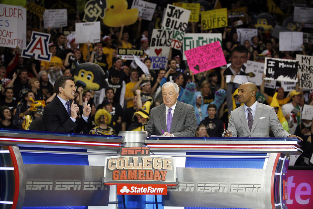 From left to right, Rece Davis, anchor of College GameDay, Digger Phelps and Jay Williams discuss various topics around the college basketball world during the ESPN College GameDay broadcast at the Coors Events Center, Saturday, Feb. 22, 2014, in Boulder, Colo. (Kai Casey/CU Independent)