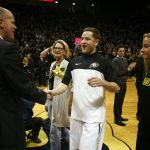 Colorado senior guard shakes hands with head coach Tad Boyle on Senior Day before an NCAA college basketball game between the Colorado Buffaloes and the No. 4 Arizona Wildcats at the Coors Events Center, Saturday, Feb. 22, 2014, in Boulder, Colo. (Kai Casey/CU Independent)