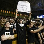 A Colorado fan holds up a sign for the Wildcats during an NCAA college basketball game between the Colorado Buffaloes and the No. 4 Arizona Wildcats at the Coors Events Center, Saturday, Feb. 22, 2014, in Boulder, Colo. (Kai Casey/CU Independent)