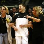 Colorado senior guard Beau Gamble walks out with his mom and sister on Senior Day during an NCAA college basketball game between the Colorado Buffaloes and the No. 4 Arizona Wildcats at the Coors Events Center, Saturday, Feb. 22, 2014, in Boulder, Colo. (Kai Casey/CU Independent)
