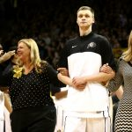 Colorado senior center Ben Mills walks out with his mom and sister on Senior Day during an NCAA college basketball game between the Colorado Buffaloes and the No. 4 Arizona Wildcats at the Coors Events Center, Saturday, Feb. 22, 2014, in Boulder, Colo. (Kai Casey/CU Independent)