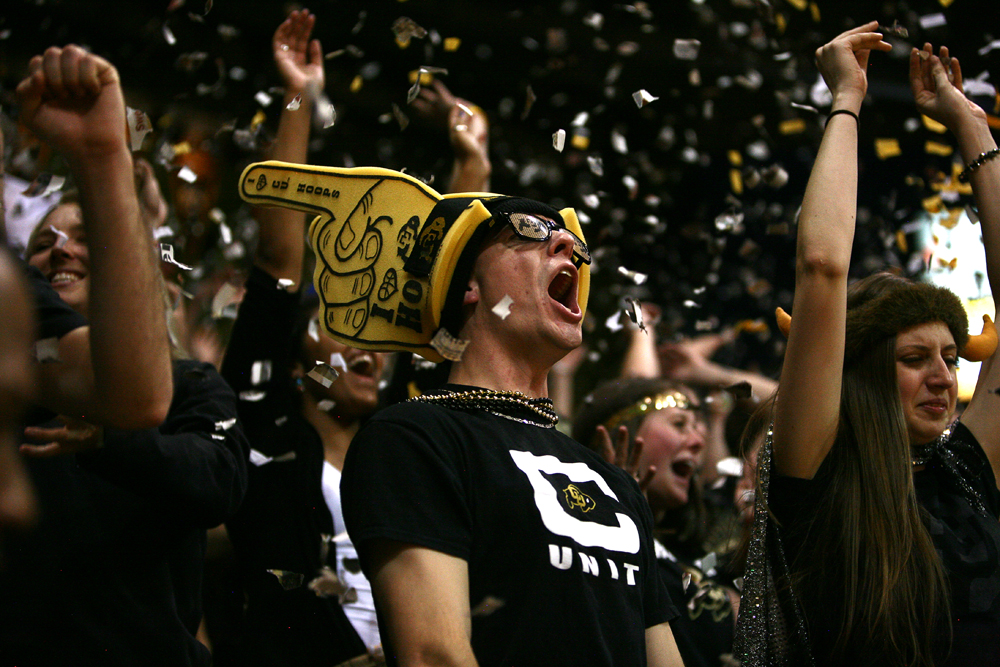 The C-Unit erupts after Colorado finally scored their first field goal halfway through the first half during an NCAA college basketball game between the Colorado Buffaloes and the No. 4 Arizona Wildcats at the Coors Events Center, on Saturday in Boulder, Colo. (Kai Casey/CU Independent)