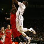 Colorado forward Xavier Johnson (2) jumps for a layup past an Arizona defender during an NCAA college basketball game between the Colorado Buffaloes and the No. 4 Arizona Wildcats at the Coors Events Center, Saturday, Feb. 22, 2014, in Boulder, Colo. (Kai Casey/CU Independent)