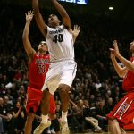 Colorado forward Josh Scott (40) lays the ball in past Arizona's Nick Johnson (13) during an NCAA college basketball game between the Colorado Buffaloes and the No. 4 Arizona Wildcats at the Coors Events Center, Saturday, Feb. 22, 2014, in Boulder, Colo. (Kai Casey/CU Independent)