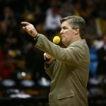 Colorado head football coach Mike MacIntyre addresses the crowd during halftime of an NCAA college basketball game between the Colorado Buffaloes and the No. 4 Arizona Wildcats at the Coors Events Center, Saturday, Feb. 22, 2014, in Boulder, Colo. (Kai Casey/CU Independent)