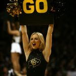 A Colorado cheerleader leads the crowd in a chant during a timeout during an NCAA college basketball game between the Colorado Buffaloes and the No. 4 Arizona Wildcats at the Coors Events Center, Saturday, Feb. 22, 2014, in Boulder, Colo. (Kai Casey/CU Independent)