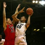 Colorado forward Josh Scott (40) goes up against Arizona's Kaleb Tarczeski (35) for a layup during an NCAA college basketball game between the Colorado Buffaloes and the No. 4 Arizona Wildcats at the Coors Events Center, Saturday, Feb. 22, 2014, in Boulder, Colo. (Kai Casey/CU Independent)