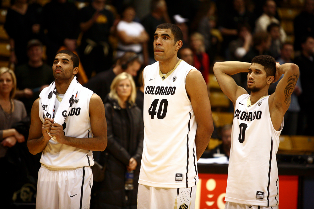 From left to right, Colorado's Xavier Talton, Josh Scott and Askia Booker stand dejectedly after losing 87-61 in an NCAA college basketball game between the Colorado Buffaloes and the No. 4 Arizona Wildcats at the Coors Events Center, Saturday, Feb. 22, 2014, in Boulder, Colo. (Kai Casey/CU Independent)