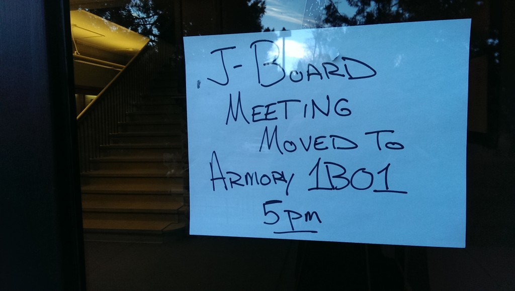 One of two signs that appeared in the University Avenue entryway to the Armory on Thursday. Article V of bylaws proposed to Journalism Board on Thursday stipulated that  all members of the journalism student body be informed if a change occurs to the board's meeting schedule. (Alison Noon/CU Independent)