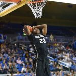 Freshman Jaron Hopkins elevates for a massive dunk at Pauley Pavilion.(Nigel Amstock/CU Independent)