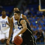 Colorado guard Askia Booker navigates his way around Bruin defenders at Pauley Pavilion. (Nigel Amstock/CU Independent)
