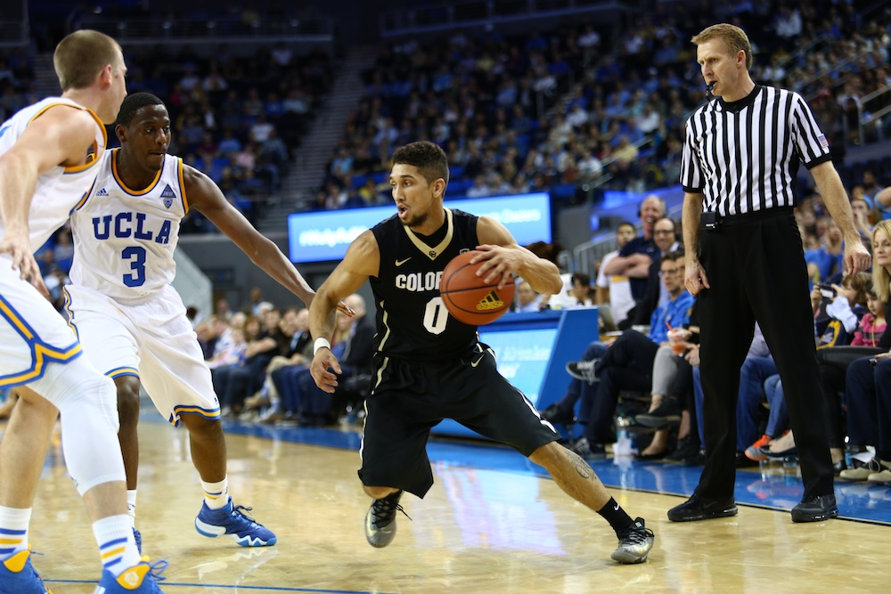 Colorado guard Askia Booker looks for an open lane between the Bruin defenders at Pauley Pavilion. (Nigel Amstock/CU Independent)
