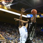 Colorado Forward Xavier Johnson lobs the ball toward the UCLA basket in the second half of play at Pauley Pavilion. (Nigel Amstock/CU Independent)