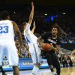Colorado forward Xavier Johnson drives through a crowd of Bruin defenders late in the second half at Pauley Pavilion. (Nigel Amstock/CU Independent)