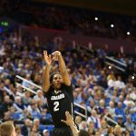 Colorado forward Xavier Johnson attempts a long 3-pointer over a Bruin defender late in the second half of play at Pauley Pavilion. (Nigel Amstock/CU Independent)