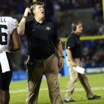 Colorado Coach Mike MacIntyre questions a ruling on the field during a game against UCLA on Nov. 2, 2013. (Nigel Amstock/CU Independent)