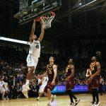 Center Josh Scott dunks the ball over the Arizona St. defense. (Matt Sisneros/CU Independent)
