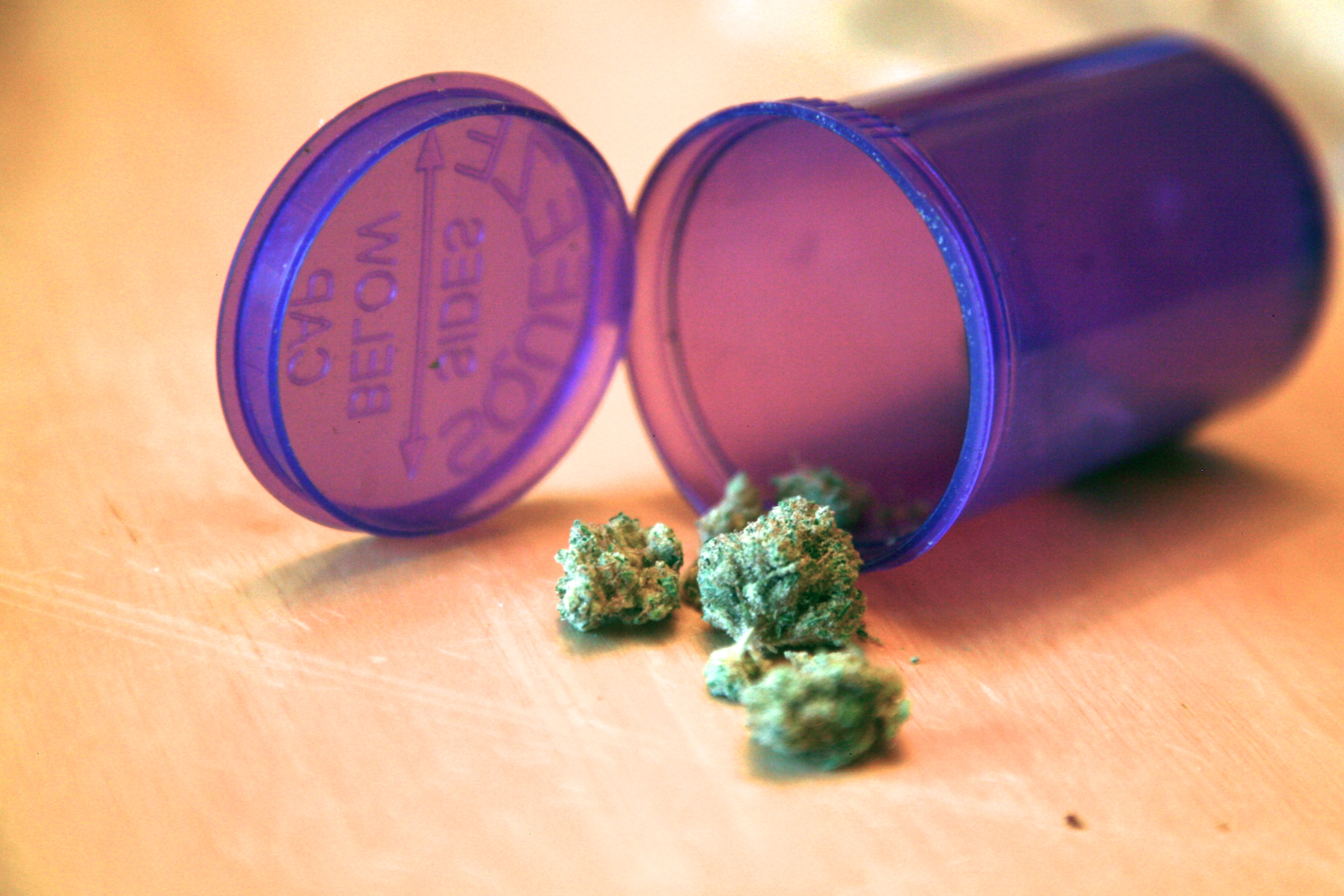 A container of marijuana sits on a table. (Nate Bruzdzinski)