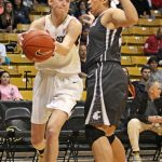 Colorado junior Lexy Kresl looks for a way around a defending Washington State player. Kresl scored five points out of the team's overall 77-point game. (Maddie Shumway/ CU Independent)