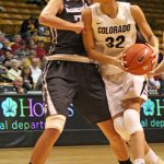 Colorado sophomore Arielle Roberson (32) looks to drive toward the basket against her defender. (Maddie Shumway/CU Independent)