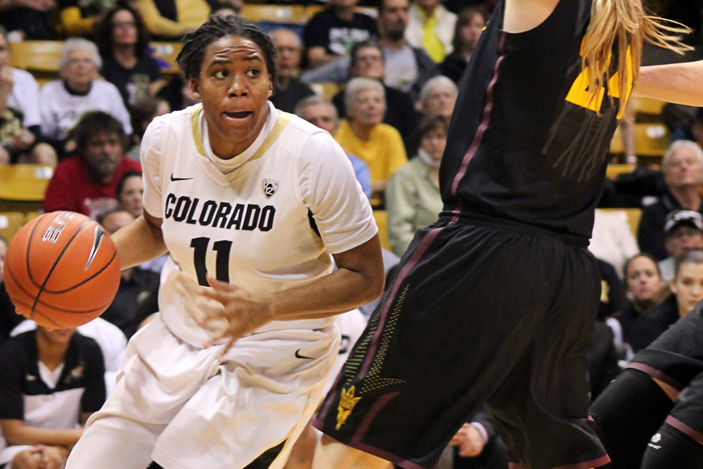 Colorado senior guard Brittany Wilson (11) runs the ball towards the net during the Colorado and Arizona State game on Jan. 26, 2014, at Coors Event Center in Boulder, Colo. Wilson scored 12 points out of the team's 66 point game. (Maddie Shumway/CU Independent File)