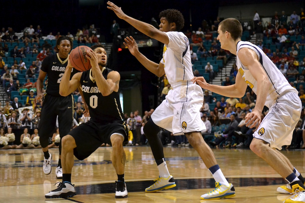 Askia Booker (0) throws a head-fake against Cal Thursday, March 2, 2014 in Las Vegas, Nev. (Nate Bruzdzinski/CU Independent)
