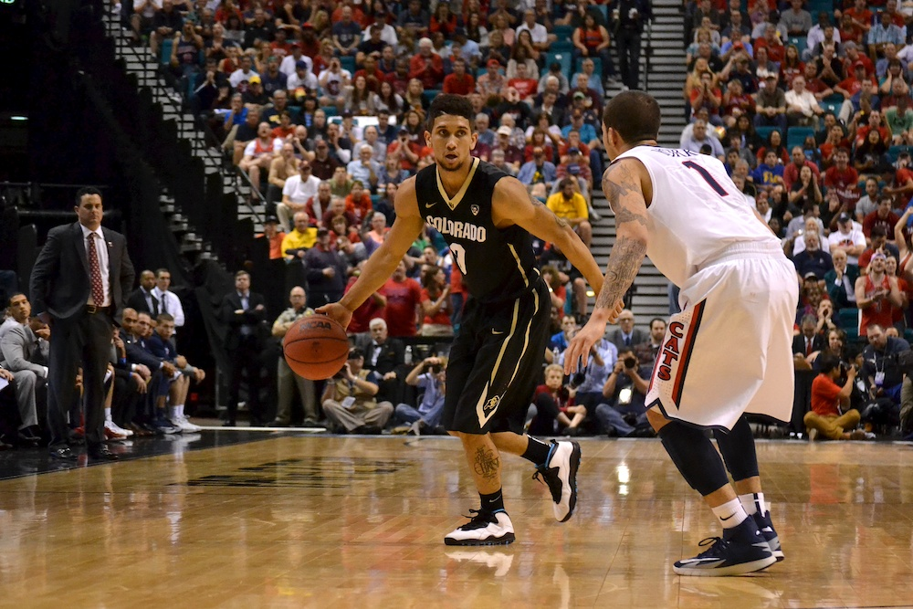 Guard Askia Booker (0) dribbles the ball around the perimeter during the second half against Arizona Friday, March 14, 2014 at the MGM Grand Garden Arena in Las Vegas, Nev. (Nate Bruzdzinski/CU Independent)