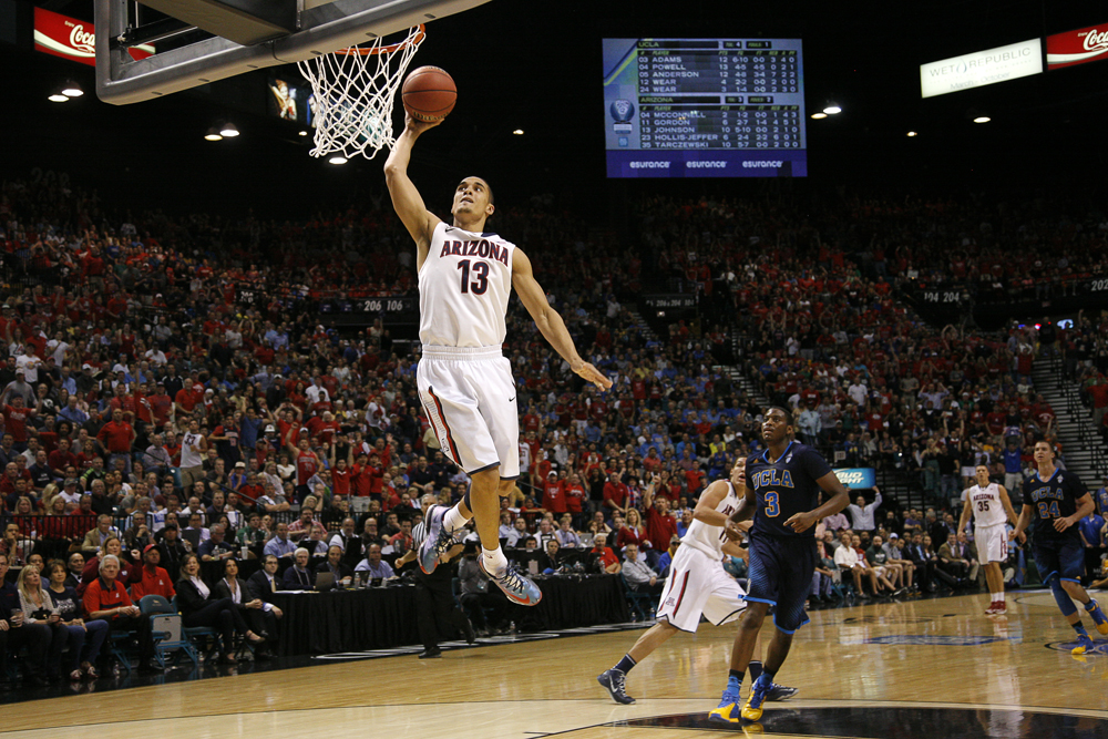 Arizona junior guard Nick Johnson (13) throws down a one-handed dunk on a fast break during the Pac-12 Tournament championship game between UCLA and Arizona Saturday, March 15, 2014, at the MGM Grand Garden Arena in Las Vegas, Nev. (Kai Casey/CU Independent)