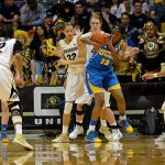 UCLA junior center Luiana Livulo (13) grabs a rebound in front of Colorado's Arielle Roberson (32) and Rachel Hargis (40) on Friday. (Elizabeth Rodriguez/ CU Independent)