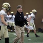Coach Mike MacIntyre discusses a blown assignment in a drill with incoming freshman defensive back Ryan Moeller at practice on March 7, 2014. (Matt Sisneros/CU Independent)
