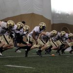 The defensive unit runs sprints at the end of practice on March 7, 2014. (Matt Sisneros/CU Independent)