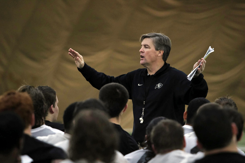 Head coach Mike MacIntyre addresses the team at the end of practice on March 7, 2014. (Matt Sisneros/CU Independent)