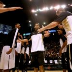 Askia Booker high-fives his teammates as the starting line-ups are announced against Cal Thursday, March 13, 2014 at the MGM Grand Garden Arena in Las Vegas, Nev. (Nate Bruzdzinski/CU Independent)