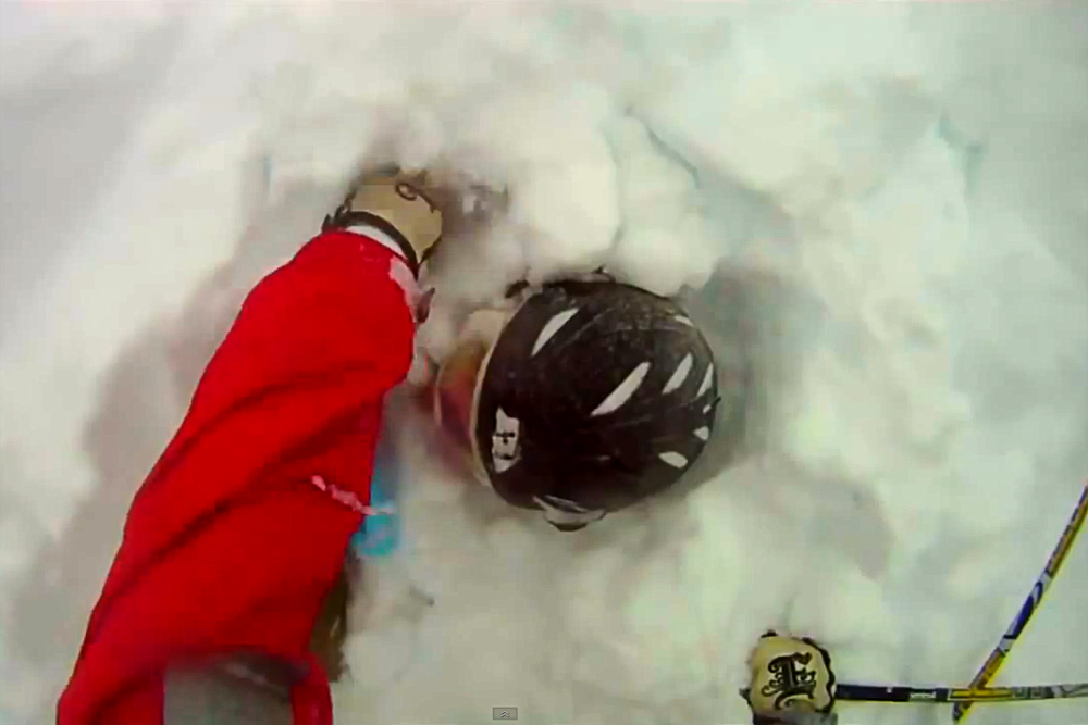 Davis LaMair digs his brother Edwin out of deep snow after Edwin got caught in an avalanche Dec. 22 in the East Vail Chutes. (Screenshot of Davis LaMair's GoPro Video)