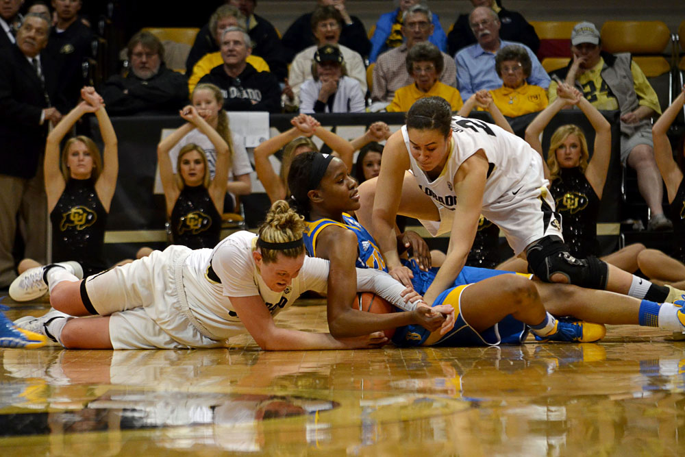 Colorado's Jen Reese, left, and Haley Smith, right, struggle for possession of the ball with a UCLA player at Friday night's game. (Elizabeth Rodriguez/ CU Independent)