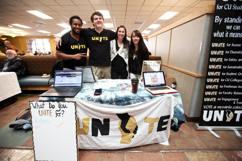 Members of the UNITE ticket (L-R): Juedon Kebede, Tri-Executive-elect, Jon Heisler, candidate for ASSG representative, Lora Roberts, candidate for Tri-Executive, and Thao Bui, volunteer, table in the University Memorial Center during the first day of CUSG Elections, April 7, 2014. (James Bradbury/CU Independent)