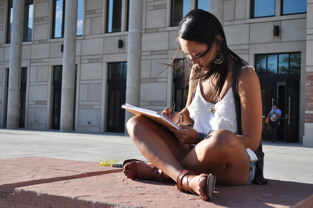 Eva Weinberg, a sophomore studio art major sketches outside the Visual Arts Complex.  Every semester students pay an Arts and Cultural Enrichment Fee. (James Bradbury/CU Independent)