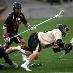 Colorado's Michael Simbowski (53) gets tripped up by a Utah defender as he tries to shoot during a men's club lacrosse game between No. 2 Colorado and Utah, Saturday, April 12, 2014, at Folsom Field. (Kai Casey/CU Independent File)