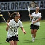 Colorado freshman attacker/midfielder Katie Macleay (13) brings the ball around the net during a women's lacrosse game between Colorado and California, Sunday, April 20, 2014, at Kittredge Field in Boulder, Colo. The Buffs lost 6-7. (Kai Casey/CU Independent)